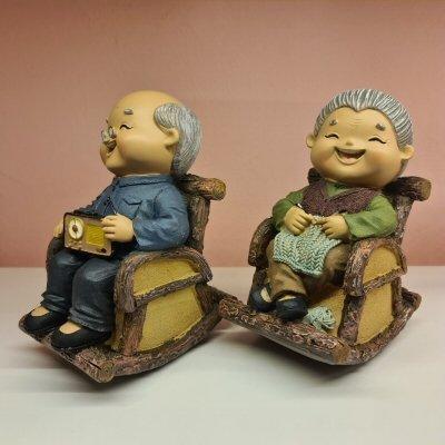 Elder Figurines Relaxing Wooden Chairs